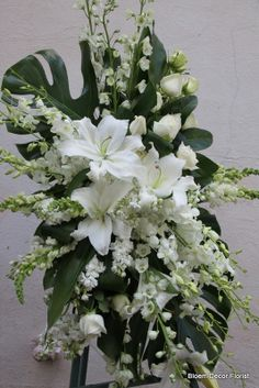 For bridal bouquet but more solid tropical leaf. Large spray with Casablanca lilies, white roses, white delphinium, white stock, snapdragon and aspidistra on philodendron leaves. Bridal Shower Games Prizes, Bridal Shower Favors Diy, Bridal Shower Centerpieces, Bridal Shower Rustic, Table Centerpieces, Backyard Bridal Showers, Beach Bridal Showers, Easter Flower Arrangements, Silk Arrangements