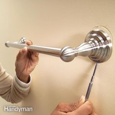 Towel bars mounted on drywall need to be firmly anchored or they'll eventually fall off. Replace light-duty plastic anchors with heavy-duty anchors that will keep towel bars in place even after years of hard use.