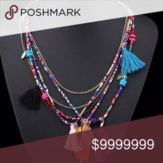 Fringe tassel boho multicolored Multi-Strand Beautiful beaded, tassel multicolored necklace. Fun multi strand piece. Model manikin is a size 4. Jewelry Necklaces