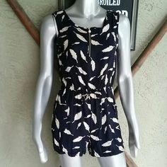 Navy & Tan Feather Print Romper Feather Print In Navy & Tan Polyester/Rayon Fabric. Elastic waistband with Zipper Neck front. Zipper pull pearl hardware. Side front pockets  Size Small  Perfect for that up coming cruise. This was purchase in a Malaysia Fashion Market.  New no vendor Brand or tags but comes in plastic bag purchased in. Shorts