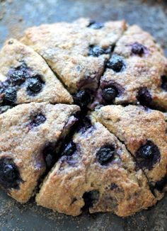 Ahealthy, lightened up Whole Grain Scone made with Greek Yogurt bursting with the sweet blueberries found at the local farmer's market this summer.
