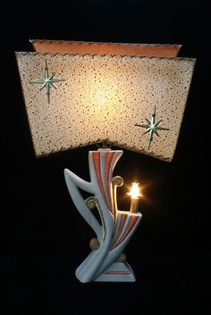 "One of my favourite 1950's lamp pics--pink, white & gold atomic lamp with starburst fiberglass tier shade. I have two in blue. They are unmarked but I've often heard them referred to as ""Majestic""."