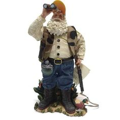Santa is Out Standing in the cattails looking for ducks with his binoculars. He is wearing his hunting vest and has his duck decoy with him.  Kurt Adler KSA Rare Duck Hunting Santa Fabriche Tabletop Figurine  • Retired from Production  • Item Number 5529  • 12 Tall X 6 Wide  Is in very