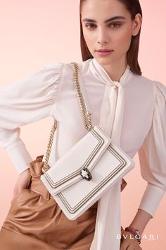 Diamond Blast shoulder bag in white agate smooth calf leather featuring a three-chain motif in light gold and palladium finishing. Light gold plated brass snakehead closure decorated with black and white enamel and black onyx eyes.