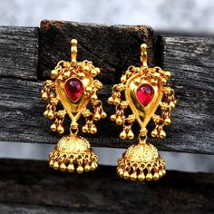 Pretty jhumka on board...4000rs pair... Stunning silver jumkhi with gold polish.Available colors : gree  09 December 2018