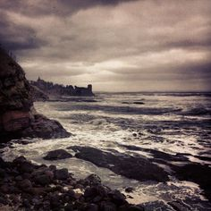 St Andrews Castle and the stormy North Sea - Photo by pisnya