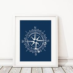 Nautical Compass Art Print:  This print features the image of a compass on a solid background. The colors used are white and navy blue, from