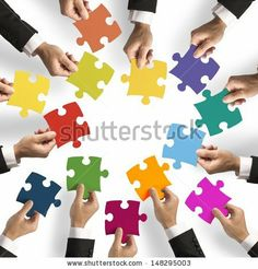 Teamwork and integration concept with puzzle pieces by alphaspirit, via Shutterstock
