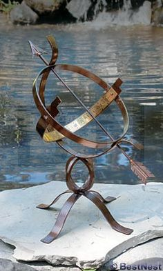 Place the Armillary Sundial with it's arrot pointing celestial north for accurate timekeeping in the garden! The arrow runs diagonally through the dark brown frame, casting a shadow onto the brass ban