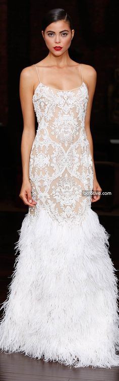 Naeem Khan I usually don't like feathers on a long wedding dress, but these lay down nicely. I love upper design of the dress and the hair keeps the look elegant and classy