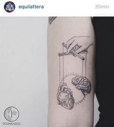 brain vs heart tattoo