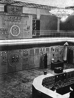 Computer Room. 1950s Never saw one with a chandelier before.  :) Probably an old ballroom or theater.