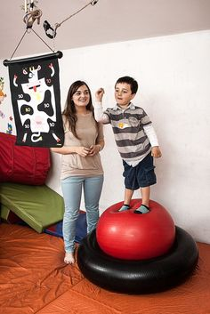 Using an inner tube and a therapy ball in combination to work on dynamic balance. This encourages the child to separate upper and lower limb movement when they are encouraged to throw and catch at the same time. - repinned by @PediaStaff – Please Visit ht.ly/63sNt for all our ped therapy, school & special ed pins