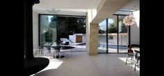 these sliding glass doors with flush floor tracks are perfect for pool areas