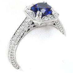 unique square stone with clipped corners. The exquisite detail of half-moons accented with micro pavé diamonds surround the 1.30 carat round blue sapphire.  #engagement #wedding #ring www.knoxjewelers.biz