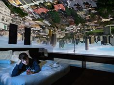Robyn Stacey- Photographs her sitter in a hotel room. The room becomes a camera obscura which enables the outside world to project upside down onto the interior of the room.