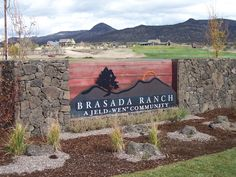 The beautiful masonry monument sign with dimensional images and lettering to welcome guests at Brasada Ranch.