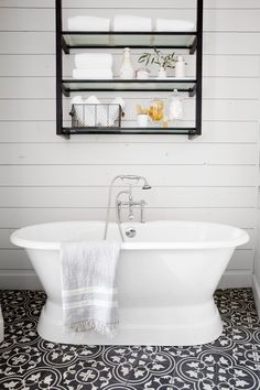 """""""As much as I love white subway tile and white shiplap, I know when there's too much white. This floral tile is bold, but the black color keeps it feeling classic,"""" says Joanna Gaines of the patterned tile."""
