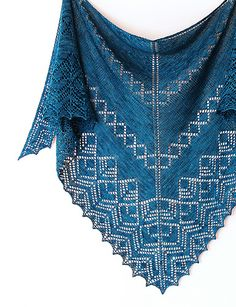 Wilshire is a contemporary lace top-down triangular shawl inspired by the…