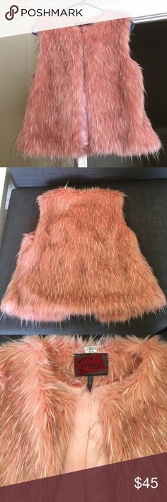 """Pink Faux Fur Vest. This sumptuously soft faux vest brings a luxe looking finish to rock ' n ' roll ensembles. This item runs small.  23"""" long from high point of shoulder to hem, hook closure, self : 80% acrylic / 20 % polyester.  Lining : 100% polyurethane - coated polyester.  Brand new without tags. Celsius Jackets & Coats Vests"""
