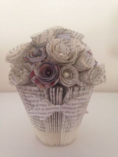 Handmade folded book art bucket vase and selection of paper flowers by Onlypaper123 on Etsy https://www.etsy.com/listing/244032768/handmade-folded-book-art-bucket-vase-and