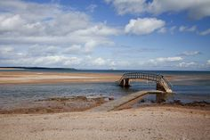 The footbridge known as The Bridge To Nowhere at Belhaven Bay near Dunbar, East Lothian, Scotland. Scotland Vacation, Countries Of The World, Far Away, Northern Ireland, Beautiful Beaches, Kayaking, Places To Visit, Around The Worlds, Bridges
