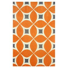 Anchor your dining table or living room seating group in style with this hand-tufted rug, showcasing a geometric motif in deep orange.