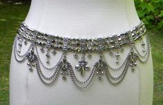 An ornate and elaborate chain belt with beads, chains, and Fleur De Lis charms theme, a one of a kind creation handmade by me, Erica. $100.00 https://ericascreativecavalcade.com/products/fleur-de-lis-chain-belt