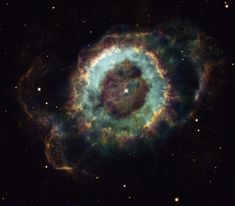 Little Ghost Nebula (NGC 6369) - In the constellation Ophiuchus (the Serpent bearer), between 2,000-5,000 light-years away, is this planetary nebula. blue : ionized oxygen atoms which lost 2 electrons - green : ionized hydrogen which has lost its single electron - red : ionized nitrogen atoms which have lost only one electron