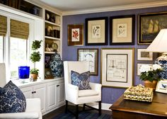 blue & white -- thin white & navy stripe wallpaper, interesting way of hanging prints & paintings almost to the floor. Blue patterned pillows on crisp white chairs. Direct link: http://covetdujour.blogspot.com/2011/04/daily-inspiration-barclay-butera.html