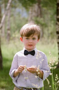 Ring bearer with black bowtie and lilac gingham button up shirt.  Photo by Carrie Patterson.