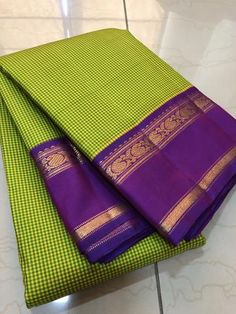 Beautiful handwoven pure kanjivaram silk in a gorgeous lemoney yellow and green checkered body with purple rettai plate borders with rich woven pallu and contrast woven blouse cost