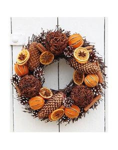 Deliver me a Christmas tree | T 01732 522471 | BCTGA Members |. Real large Christmas door wreath made from willow and decorated with star anise, oranges and pine cones.