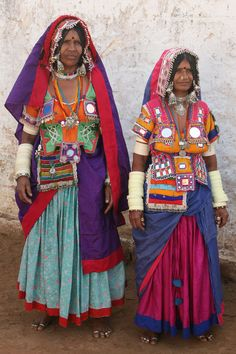 INDIA | ROMA Banjara (Lambadi) tribal women in traditional dress, Raikal village. The nomadic Indian Banjara peoples originated in the northern state of Rajasthan, which is also thought to be the origin site of the nomadic European Roma peoples.