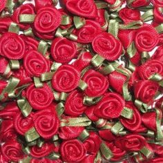 Pack of 100 Red satin ribbon roses by an, http://www.amazon.co.uk/dp/B00E3D7A7Q/ref=cm_sw_r_pi_dp_cEp6sb1PTS9K5