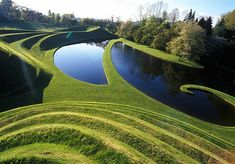 The Garden of Cosmic Speculation, designed by architecture critic Charles Jencks, is a stunning garden at Portrack House in Scotland.