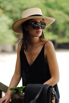 Summer fashion, perfectly accessorized with a hat, black oversized sunnies & black bag.