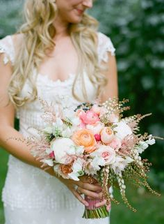 peach and pink bridal bouquet with pieris japonica