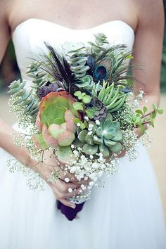 Baby's breath, peacock feathers, eucalyptus. Maybe with a fresh flower or two, these would be perfect.
