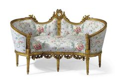 A GILTWOOD CANAPE FIRST QUARTER 20TH CENTURY...M.Taylor: I think this is what a True loveseat is. It forces the two people sitting on it to face each other with their knees touching