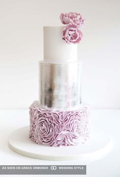 silver wedding cake with lilac pink rosette ruffles and peonies