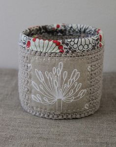 Love the combination of crochet and fabric....the possibilities are endless!! Linen basket by Katia Donohoe, via Flickr