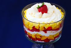 Trifle: layered angel food cake, fresh fruit (pineapple, peaches and strawberries) and bourbon whipped cream.