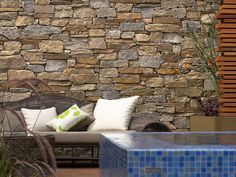 Eco Outdoor Alpine drystone feature wall behind mosaic pool, design by Rollingstone Landscapes. | Eco…