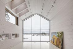 This unassuming family home in Finland is designed by OOPEAA, or Office for Peripheral Architecture. OOPEAA strives for an architecture that finds i. Cabinet D Architecture, Interior Architecture, Interior And Exterior, Windows Architecture, Interiores Design, Cabana, Living Spaces, Living Room, New Homes