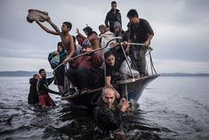 Image result for Sergey Ponomarev: Pulitzer Prize Winner for his photography documenting the migrant exodus to Europe, 2016