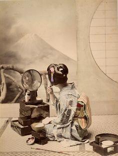 A Japanese Geisha applying her make-up. #portraits #vintage #Asian #Japanese