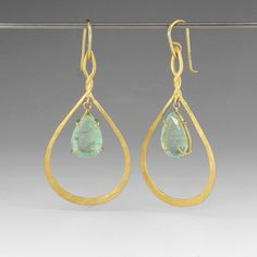"22k gold tangier earrings with an emerald drop set in 18k gold. Earrings measure 2"" long and 1"" wide at its widest point."