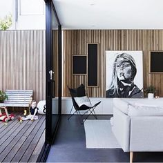 I love how the timber panelling stretches from the interior to exterior to make the space feel larger simply genius!  Via @barnaby_lane  #interiordesign #interiors #stylist #timberwall #panelling #loungeroom #homeinspo
