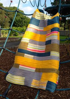 Geometric Stripe Quilt in Mustard Grey and Petrol Blue, Lap Quilt. via Etsy.